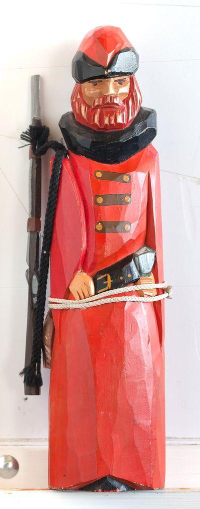 Wooden sculpture. An Archer-hunter